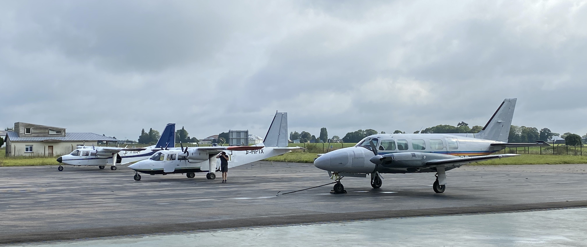 Three aircraft lined up on the flight line
